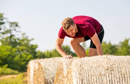 Haystack obstacles at the extreme race overcome by runner