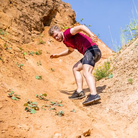 Runner during obstacles course training in the boot camp Stockfoto