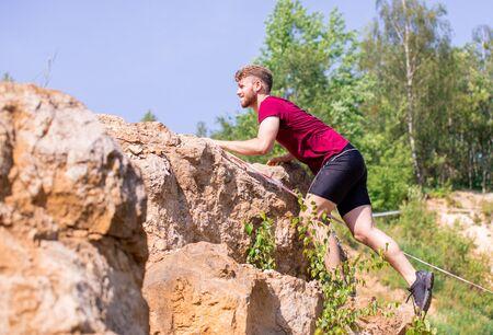 Runner overcome rocks obstacles in the cross-country race Reklamní fotografie