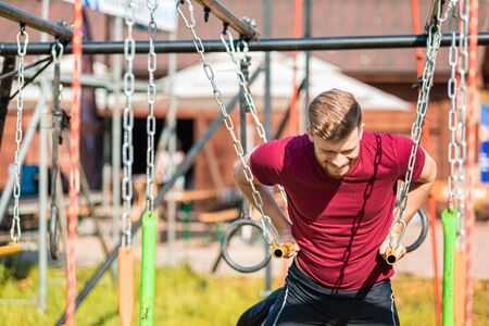 Hanging rings obstacle overcome by runner at the extreme race