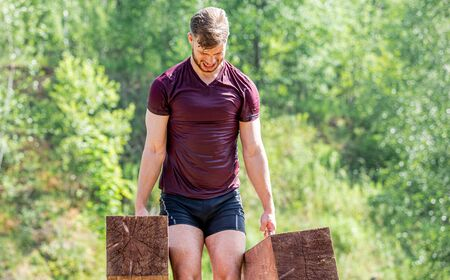 Farmer walk during obstacle race training in the boot camp