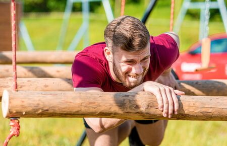 Extreme obstacles overcome by runner in the boot camp