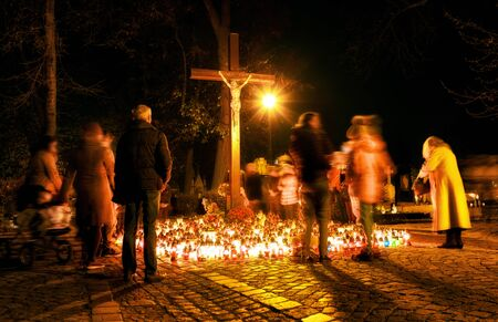 People in cemetery at All saints Day