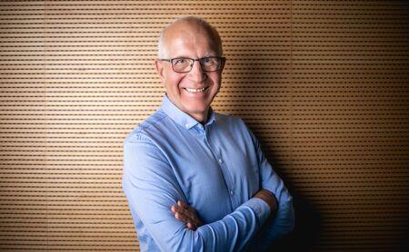 Portrait of senior businessman with eyeglasses looking at camera Banco de Imagens