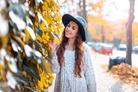 Young woman walking outdoors in autumn enjoying weather Banco de Imagens