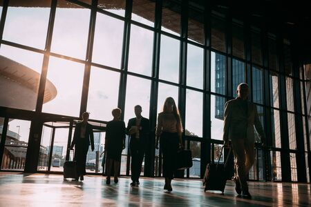 Group of business people walking in airport hall Banco de Imagens