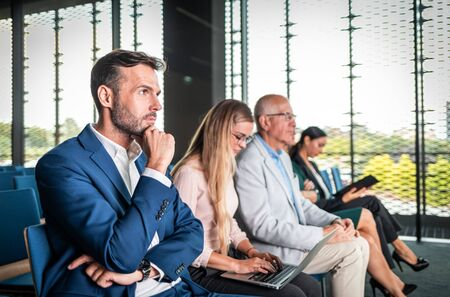 Audience listening speaker at business conference