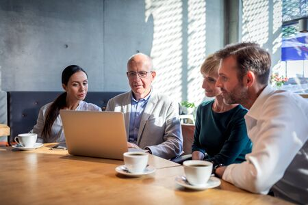 Business people talking about project in a cafe