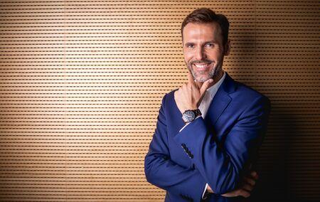 Portrait of handsome professional businessman looking at camera Banco de Imagens
