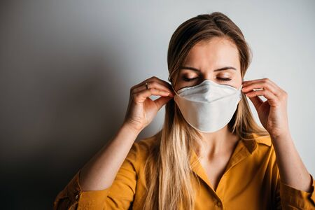 Virus mask woman puts on face protection in prevention for coronavirus