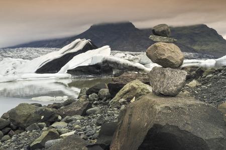 glacial: stone cairn near glacial lake
