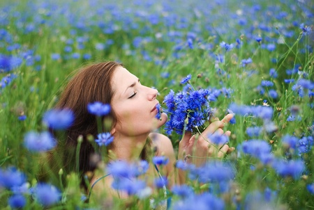 Girl with cornflowers photo