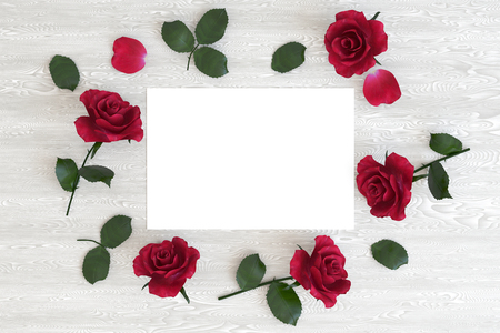 Blank card with flowers on the table, top view, mock up, 3D illustration