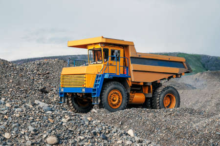Excavation work in a mountainous wooded area. A dump truck during a pause.