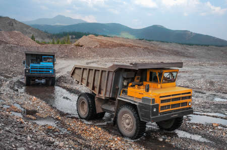 Mountainous dump truck is widely used for transporting and unloading rocks. Mining.
