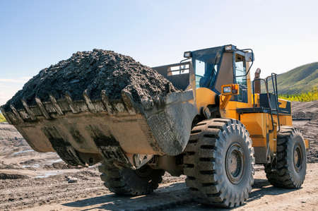 Excavation work in mountainous areas - mining. Front loaders at work.