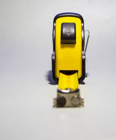 Release button for measuring tape