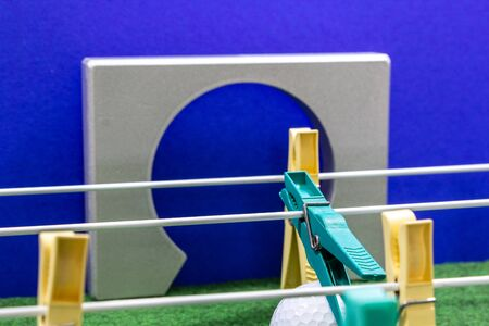clothespins lined up in the form of a football kicker