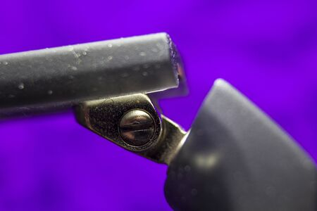 Macro picture of a screw in a spectacle frame