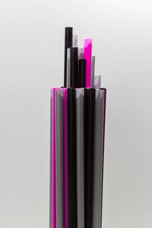colorful drinking straws in different lengths