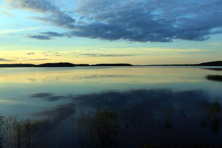 the lake looks like a mirror so quiet it is