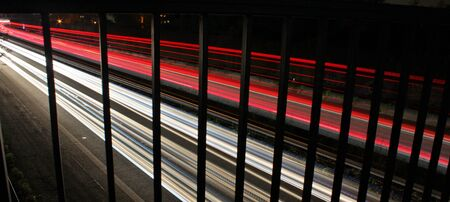 interrupted strips of light due to a bridge railing