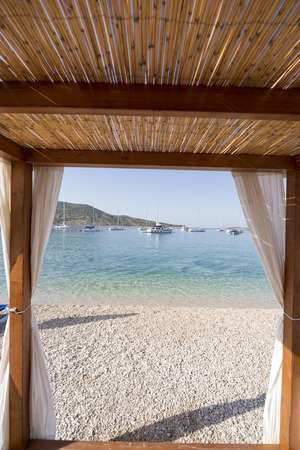 Beautiful sunny luxury beach and yachts in sea at Primosten, Croatia
