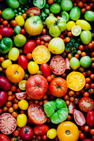 variation: Fresh heirloom tomatoes background, organic produce at a Farmers market