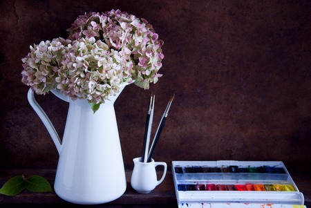 dried flower arrangement: Painting hydrangea flowers in a white jug Stock Photo