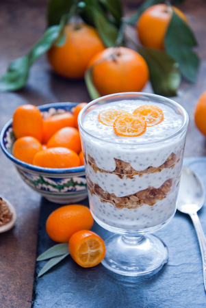 processed grains: Healthy breakfast - Chia Seed Pudding with kumquats and granola