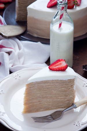 Piece of Crepe cake Napoleon with strawberries