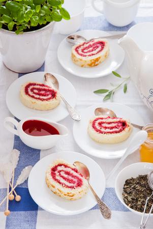 Jam roll strawberry, Raspberry Swiss Roll, Teatime with Cake roll Stock Photo