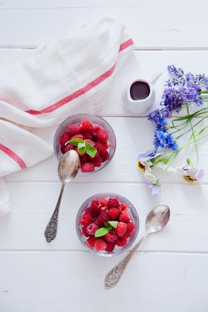 Fresh Organic Raspberries in glasses for Breakfast