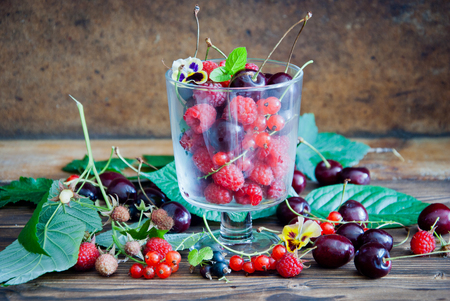 Fresh cherries, raspberries, red currant and black currant Фото со стока