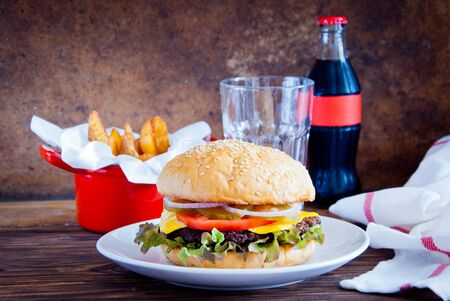 Homemade burger, Fries and Cold drink on wooden background