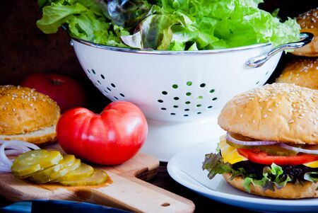 Making Homemade burger with fresh vegetables and beef