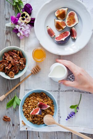 Homemade granola with fresh figs for breakfast