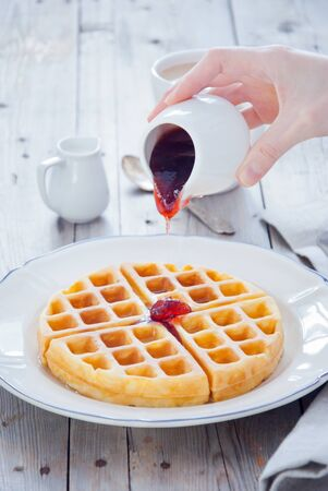 Homemade Waffles with Strawberry Jam for breakfast