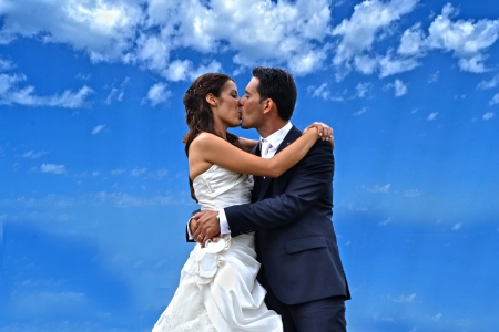 Kiss the bride and groom Stock Photo - 15095780