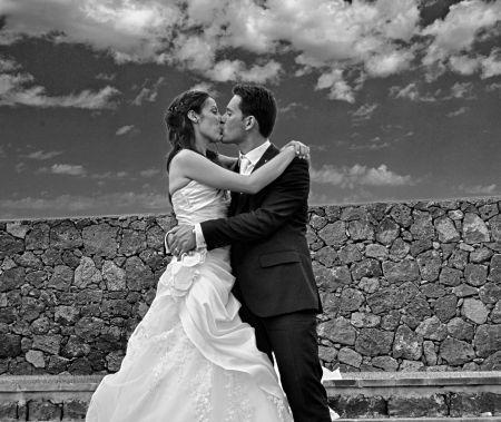 spouses: The Kiss of the Married Couple Stock Photo