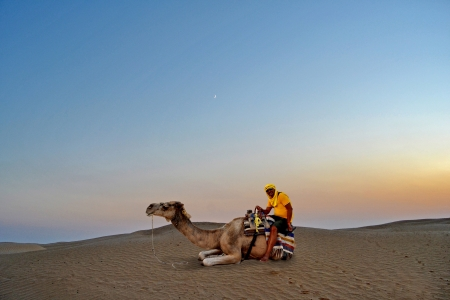 Man on camel in the Sahara desert - Tunisia, Africa photo