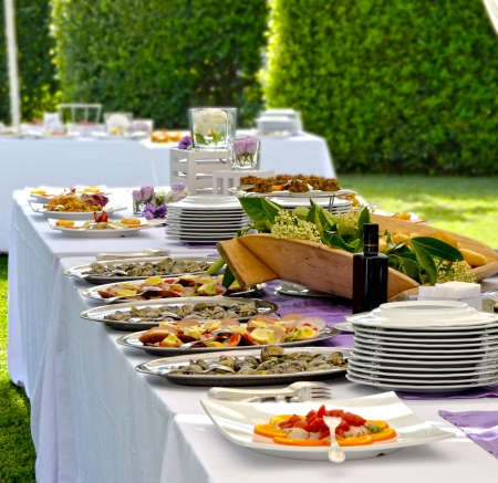 Outdoor banquet with delicious fresh dishes photo