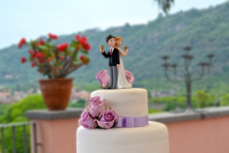 Wedding cake with bride and groom photo