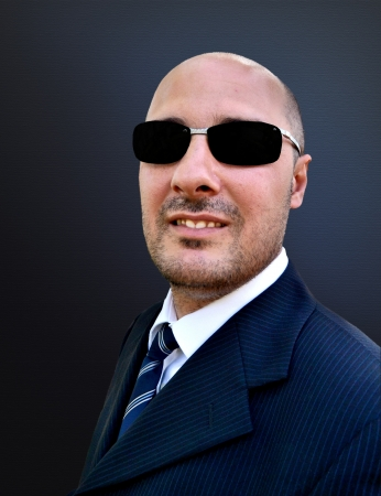 Man in elegant suit and sunglasses photo