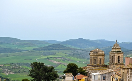 Town with hills and wind turbines - Sicily photo