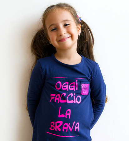 Beautiful little girl with funny inscription photo