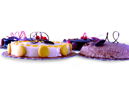 Set of decorated cakes of different flavors photo
