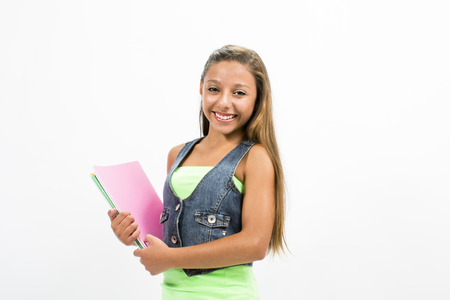 Girl student with colorful notebooks in hand photo