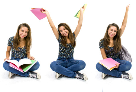 Girl student with colorful notebooks in hand Stock Photo
