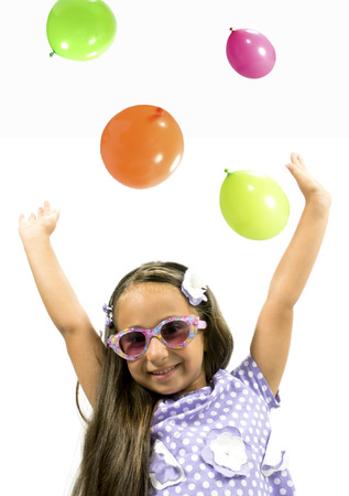 tinted glasses: Beautiful little girl smiling with colorful sunglasses